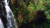 vibrante : Aerial View of Waterfall in Tropical Jungle Paradise. Natural Beauty. Amazing Waterfall Aerial Landscape. Smooth Pan