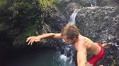 POV Slow Motion Cliff Jumping.  Lush Green Jungle in Hawaii. Extreme Sports GOPRO Selfie Stock Footage