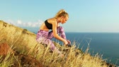 Young Athletic Woman Working out in Nature. Tying Shoes. Beautiful Sceneic Mountain View. Slow Motion