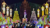 yee : 4k, timelapse, The Phra Nang Chamthewi Statue, Lamphun, Thailand 10 May, 2017: Colorful thousands lanna lanterns at night, Lamphun lantern festival. (Zoom In)