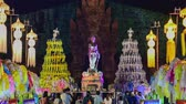 4k, timelapse, The Phra Nang Chamthewi Statue, Lamphun, Thailand 10 May, 2017: Colorful thousands lanna lanterns at night, Lamphun lantern festival. (Zoom Out)