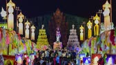 yee : 4k, timelapse, The Phra Nang Chamthewi Statue, Lamphun, Thailand 10 May, 2017: Colorful thousands lanna lanterns at night, Lamphun lantern festival. (Down-Up) Stock Footage