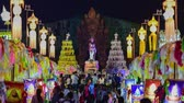 yee : 4k, timelapse, The Phra Nang Chamthewi Statue, Lamphun, Thailand 10 May, 2017: Colorful thousands lanna lanterns at night, Lamphun lantern festival.