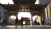 Timelapse : People activity at Jade Rooster and Golden Horse Memorial Arches, Yunnan, China