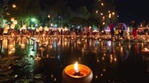 lanna : 4K Timelapse of Floating lanterns and People in Yee Peng Festival or Loy Krathong celebration at Nong Bua, San  Kamphaeng, Chiang Mai, Thailand (Zoom-Out)