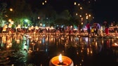 4K Timelapse of Floating lanterns and People in Yee Peng Festival or Loy Krathong celebration at Nong Bua, San  Kamphaeng, Chiang Mai, Thailand (Zoom-Out)