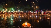 lanna : 4K Timelapse of Floating lanterns and People in Yee Peng Festival or Loy Krathong celebration at Nong Bua, San  Kamphaeng, Chiang Mai, Thailand (Zoom-In)