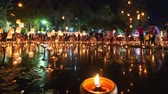 4K Timelapse of Floating lanterns and People in Yee Peng Festival or Loy Krathong celebration at Nong Bua, San  Kamphaeng, Chiang Mai, Thailand (Left-Right)