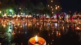 float : 4K Timelapse of Floating lanterns and People in Yee Peng Festival or Loy Krathong celebration at Nong Bua, San  Kamphaeng, Chiang Mai, Thailand (Right-Left) Stock Footage