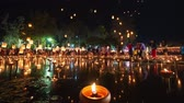 4K Timelapse of Floating lanterns and People in Yee Peng Festival or Loy Krathong celebration at Nong Bua, San  Kamphaeng, Chiang Mai, Thailand (Down-Up)