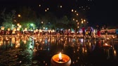 4K Timelapse of Floating lanterns and People in Yee Peng Festival or Loy Krathong celebration at Nong Bua, San  Kamphaeng, Chiang Mai, Thailand