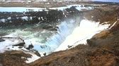 water curtain : Gullfoss waterfall view and winter Landscape picture in the winter season, Gullfoss is one of the most popular waterfalls in Iceland and tourist attractions in the canyon of the Hvita river Iceland Stock Footage