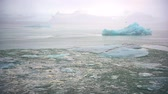 Iceberg and ice from glacier in arctic nature landscape on Iceland. Affected by climate change and global warming.