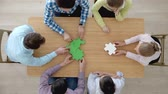 corporate : People assembling puzzle, corporate teamwork concept Stock Footage