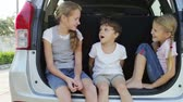 életmód : happy children sitting in car at the day time. Concept of happy youth.