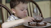 nutritious : Little boy eating cake at home at the morning time Stock Footage