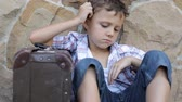 metro : Portrait of sad little boy outdoors at the day time Stock Footage