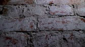 plaster : Background old brick wall with old worn bricks with holes in the wall Stock Footage