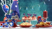 tatarak : Australian theme party table with flags and iconic food including mini pavlovas, lamingtons, meat pies and fairy bread