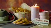 haki : Traditional ANZAC biscuits for ANZAC Day and Remembrance Day memorial holidays in vintage style setting with Australian army slouch hat.