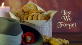 haki : Traditional ANZAC biscuits for ANZAC Day and Remembrance Day memorial holidays in vintage style setting with Lest We Forget animated text greeting message.