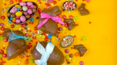 ваш : Happy Easter decadent chocolate background overhead with Easter eggs and candy on a rustic wood background with copy space.