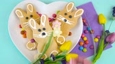 Happy Easter overhead with Easter eggs and decorations on a wood table background