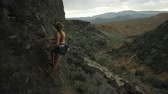 elation : girl takes in the view while rock climbing