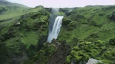 northern hemisphere : Beautiful waterfall surrounded by lush green landscape