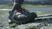 запустить : close up of shoes during a trail run