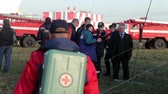 internovat : Doctors and rescuers on the field airport at the briefing