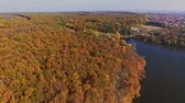 View from the top to the autumn forest and the river Стоковые видеозаписи