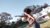 stodola : Young african woman dancing around in backyard with friends. Young men and women having fun outdoors. Dostupné videozáznamy