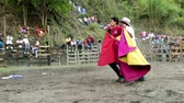tourada : BANOS DE AGUA SANTA,ECUADOR - 28 OCTOBER 2012:Improvised bullfights for the city ceremony gives people the opportunity to try out their skills in bullfighting,held in Banos de Agua Santa,Ecuador, 28 OCTOBER 2012 Stock Footage
