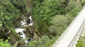 ponto alto : Suspended bridge over Pastaza river and Pailon del Diablo waterfall in Ecuadorian Andes, popular touristic destination in Ecuador Stock Footage