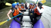 quadrilha : White water rafting team unites their paddles as a sign of success, slow motion footage from on board camera