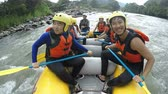 excitement : Group of nine asiatic people white water rafting rowing very slowly, on board camera, model released with sound Stock Footage