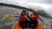 Team of seven people white water rafting. Onboard camera.