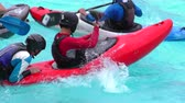 rescuing : BANOS, ECUADOR - 23 MAY 2015: Swimming pool kayak rescuing simulation in BANOS on MAY 23, 2015 Stock Footage