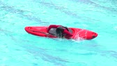 trial : BANOS, ECUADOR - 23 MAY 2015: Kayak consecutive rolls in swimming pool, one of the basic kayak self rescuing techniques in BANOS on MAY 23, 2015