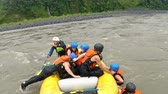 rescuing : Whitewater river rafting rescuing sequence practice by group of eight people Stock Footage