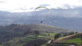 Tandem Or Dual Paragliding Pilots Flying Over Rural Area At High Altitude In South America Vídeos