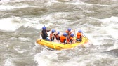 Tracking Shot Of A Whitewater River Rafting Boat With A Group Of Young Bikini Girls