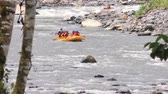 Long Distance Shot Of A Whitewater River Rafting Inflatable Boat On Calm Waters
