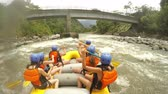 Team Of Young Adult Women On Whitewater Rafting Pilot Giving Commands With Sound