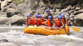 Team Of Young Adult Girls Wearing Bikini Gets Splashed On An Extreme Whitewater Rafting Trip In Ecuador Vídeos