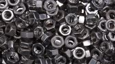 raptiye : Close up a bunch of metal nuts for industrial needs. Metal products.