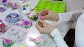 amassado : Artist makes jewelry from color Polymer Clay, artist at work. Workshop. Hobby - Art Clay Modeling. Tools for modeling. Handmade Production. Plasticine. Hands makes a pink rose Vídeos