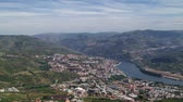 em pé : Video overlooking landscape of the Peso da Regua regions, in northern Portugal. Vineyards in the Douro Valley, Alto Douro Wine Region, officially designated by UNESCO as a World Heritage Site.