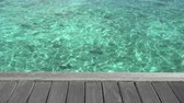 рай : clear sea water with wooden terrace Стоковые видеозаписи